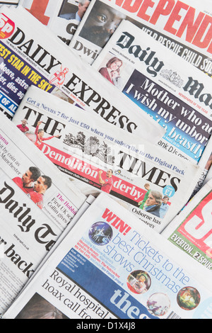 The front pages and mastheads of UK British English daily national newspapers - Stock Photo