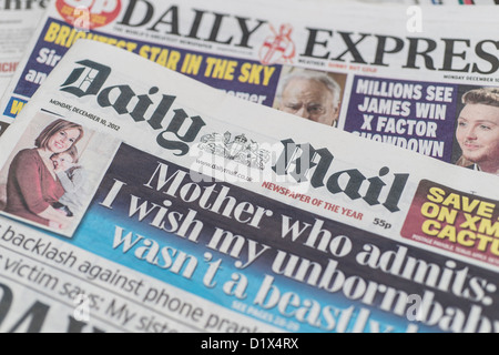 The front pages and mastheads of UK British English daily national newspapers The Daily Mail and Daily Express - Stock Photo