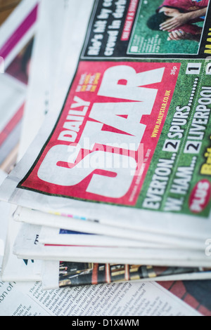 The front pages and mastheads of UK British English daily tabloid red top national newspaper The Star - Stock Photo