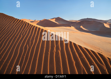 Sand dunes at Sossusvlei in Namibia - Stock Photo