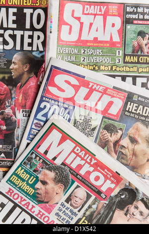 The front pages and mastheads of UK 'Red Top' tabloid tabloids Sun Star Mirror British English daily national newspapers - Stock Photo