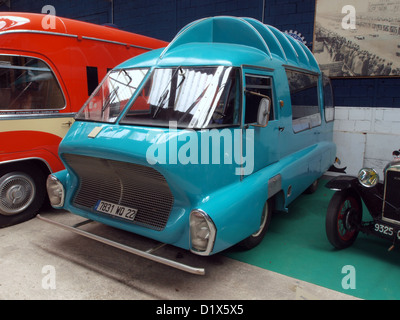 old sports car and vintage bus outside rundown house in chepstow stock photo royalty free image. Black Bedroom Furniture Sets. Home Design Ideas