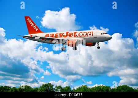 easyJet.com (easy Jet) Plane landing or taking off placed on a sunny background, close up - Stock Photo
