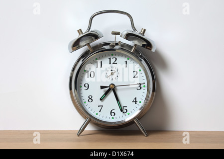 Old style chrome alarm clock with two bells. - Stock Photo