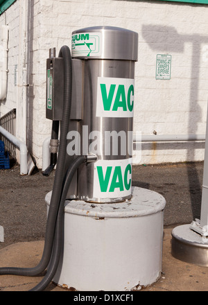 Coin operated vacuum at car wash - Stock Photo