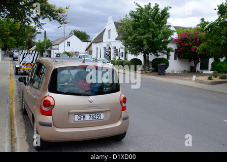 Car in street of Montague, Western Cape, South Africa. Historic Cape Dutch houses in background - Stock Photo