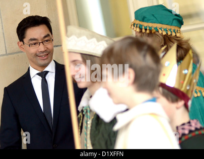 Federal Minister of Economy and Technology, Philipp Rösler (l), welcomes Sternsinger (a Star Singing Procession) - Stock Photo