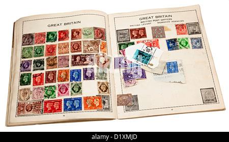 British stamps in old stamp album, UK - Stock Photo