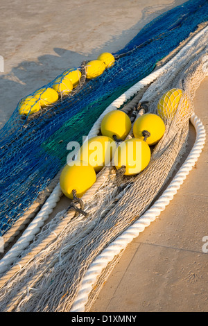 Port de Sóller, Mallorca, Balearic Islands, Spain. Colourful fishing nets and floats on the quay. - Stock Photo