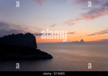 Port de Pollença, Mallorca, Balearic Islands, Spain. Pink sky over the Mediterranean after sunset, Formentor Peninsula.