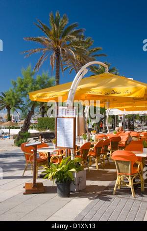 Port de Pollença, Mallorca, Balearic Islands, Spain. Colourful terrace of the Brisas bar-restaurant on the seafront - Stock Photo