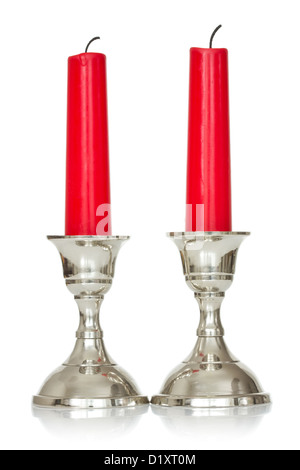 silver plated candlesticks with red candles on white background - Stock Photo