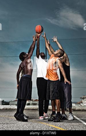 Group portrait of a street basketball team - Stock Photo