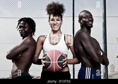 Group portrait of male and female street basket team - Stock Photo