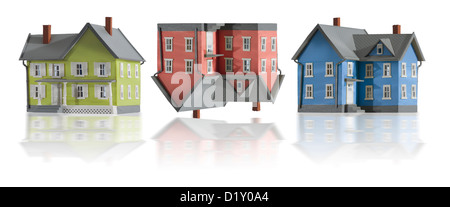 Three houses in a row.  Houses denotes creative concept of the declining real estate market. - Stock Photo