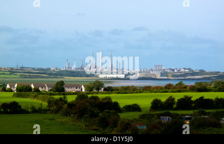 Distant view across fields from Pembroke of Milford Haven oil refinery and LNG gas terminal Pembrokeshire South Wales UK