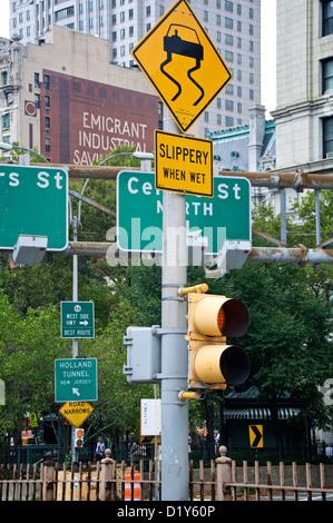 Slippery When Wet road sign in New York City, NY, USA - Stock Photo
