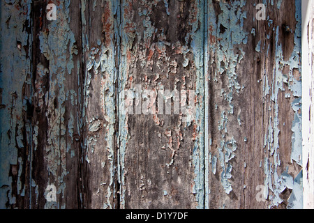 A section of an old wooden door with  chipping paint - Stock Photo