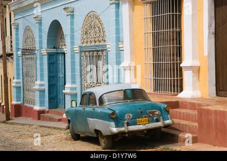 Classic American car. A cultural icon for modern day Cuba. Street Scene, Trinidad, Cuba - Stock Photo