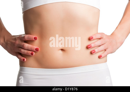 Closeup of a fit womans abs isolated on a white background - Stock Photo