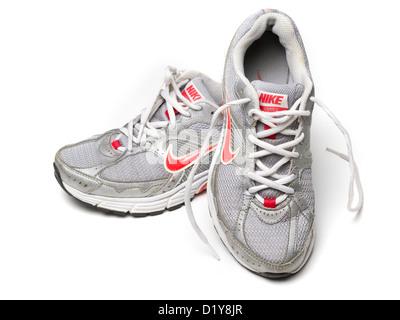 Grey Nike running shoes isolated on white background - Stock Photo