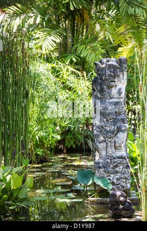 Balinese statue in the traditional gardens, Hyatt Regency Sanur, Bali, Indonesia