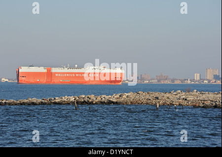 A Wallenius Wilhelmsen ship designed for heavy cargo such as automobiles, passed Coney Island in New York harbor's - Stock Photo