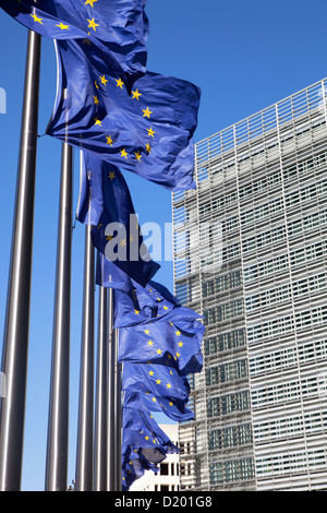 Brussels, Belgium European flags in front of the Berlaymont building - Stock Photo