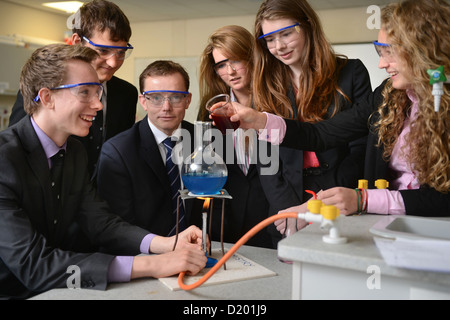 Head Master Russel Ellicott with pupils conducting a chemistry experiment during a science lesson at Pates Grammar - Stock Photo