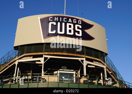 USA Illinois Chicago Wrigley Field marquee on the back side of the ballpark's scoreboard rests above the bleacher - Stock Photo