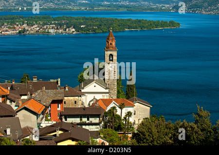 Ronco sopra Ascona with the church San Martino at the lake Lago Maggiore, Ticino, Switzerland - Stock Photo