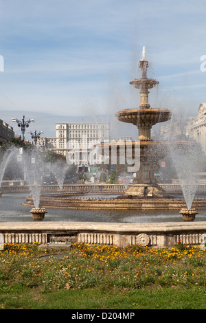 Bucharest, Romania, the place of unity with a fountain and a view towards the parliament building - Stock Photo