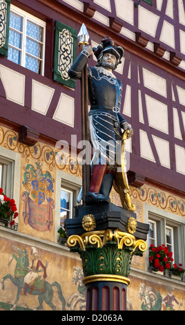 Fountain sculpture of a soldier of the Old Swiss Confederacy on the city fountain, Stein am Rhein, Switzerland - Stock Photo