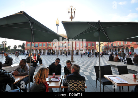 People in a cafe at Place Massena, Nice, Cote d'Azur, South France, Europe - Stock Photo