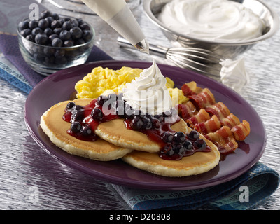 Blueberry Pancakes with Whipped Cream - Stock Photo