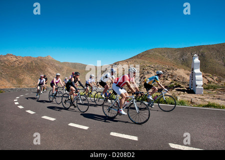 Cyclists at viewpoint Degollada de Los Granadillos, Fuerteventura, Canary Islands, Spain - Stock Photo