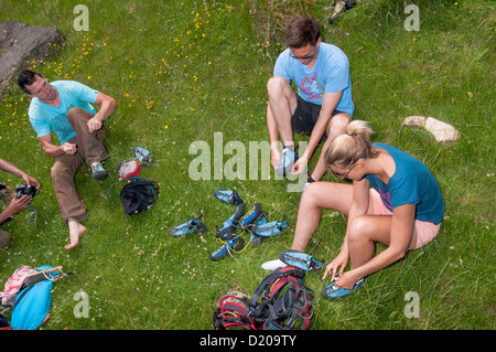 group of rock climbers talking in climbing gear - Stock Photo