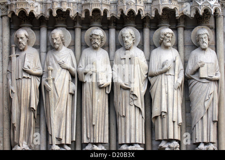Paris, Notre-Dame cathedral, detail of central portal. Paul, James the Great, Thomas, Philip, Jude, and Matthew - Stock Photo