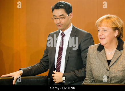 German Chancellor Angela Merkel and Economy Minister Philipp Roesler arrive for the weekly cabinet meeting in Berlin, - Stock Photo