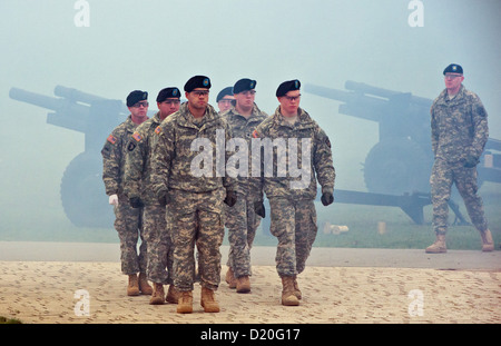 US soldiers give gun salutes on the occasion of the assumption of command by lieutenant-general Donald M. Campbell - Stock Photo