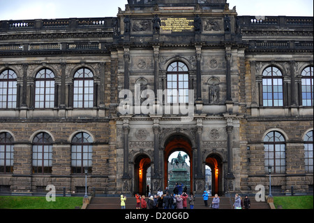 Visitors stand in front of the Semper Gallery which houses the Old Masters Picture Gallery in Dresden, Germany, - Stock Photo