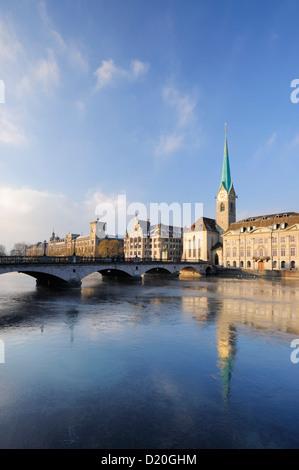 Church Frauenmuenster with river Limmat in foreground, Zurich, Switzerland - Stock Photo