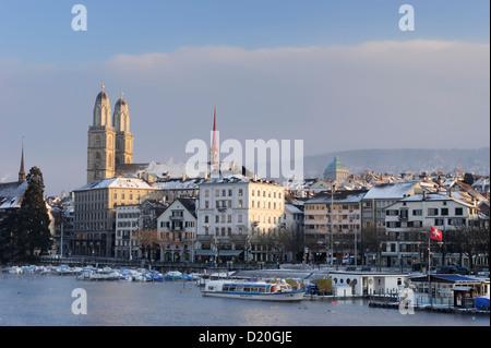 Church Grossmuenster with river Limmat in foreground, Zurich, Switzerland - Stock Photo