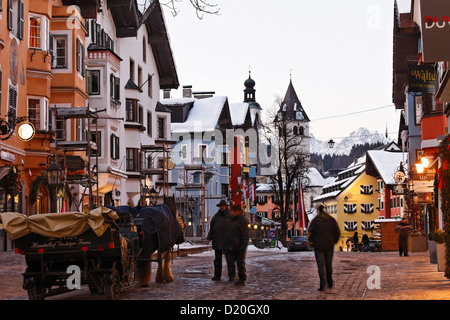 Horse Carriage, Shopping street in the evening, Old Town, Parish Church and Liebfrauen Church, Vorderstadt, Kitzbuhel, - Stock Photo
