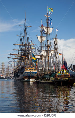 Sailing ships at harbour under clouded sky, Sail 2010, Bremerhaven, Germany, Europe - Stock Photo