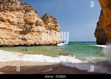People on the beach near Lagos, Atlantic Coast, Algarve, Portugal, Europe - Stock Photo