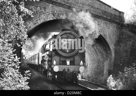 Steam Locomotive Oliver Cromwell No 70013 at high speed on the mainline though Oxfordshire October 2012 - Stock Photo