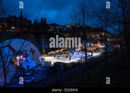 Edinburgh, midwinter - Skating rink, Edinburgh Christmas in Princes Street gardens. Castle beyond.