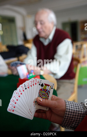 Old people playing bridge in a retirement home, Munich, Upper Bavaria, Bavaria, Germany, Europe - Stock Photo