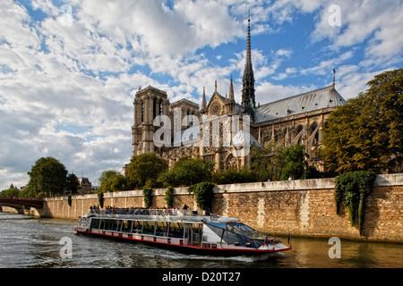 Sightseeing boat on river Seine, Ile de la Cite and Notre Dame, Paris, France, Europe - Stock Photo